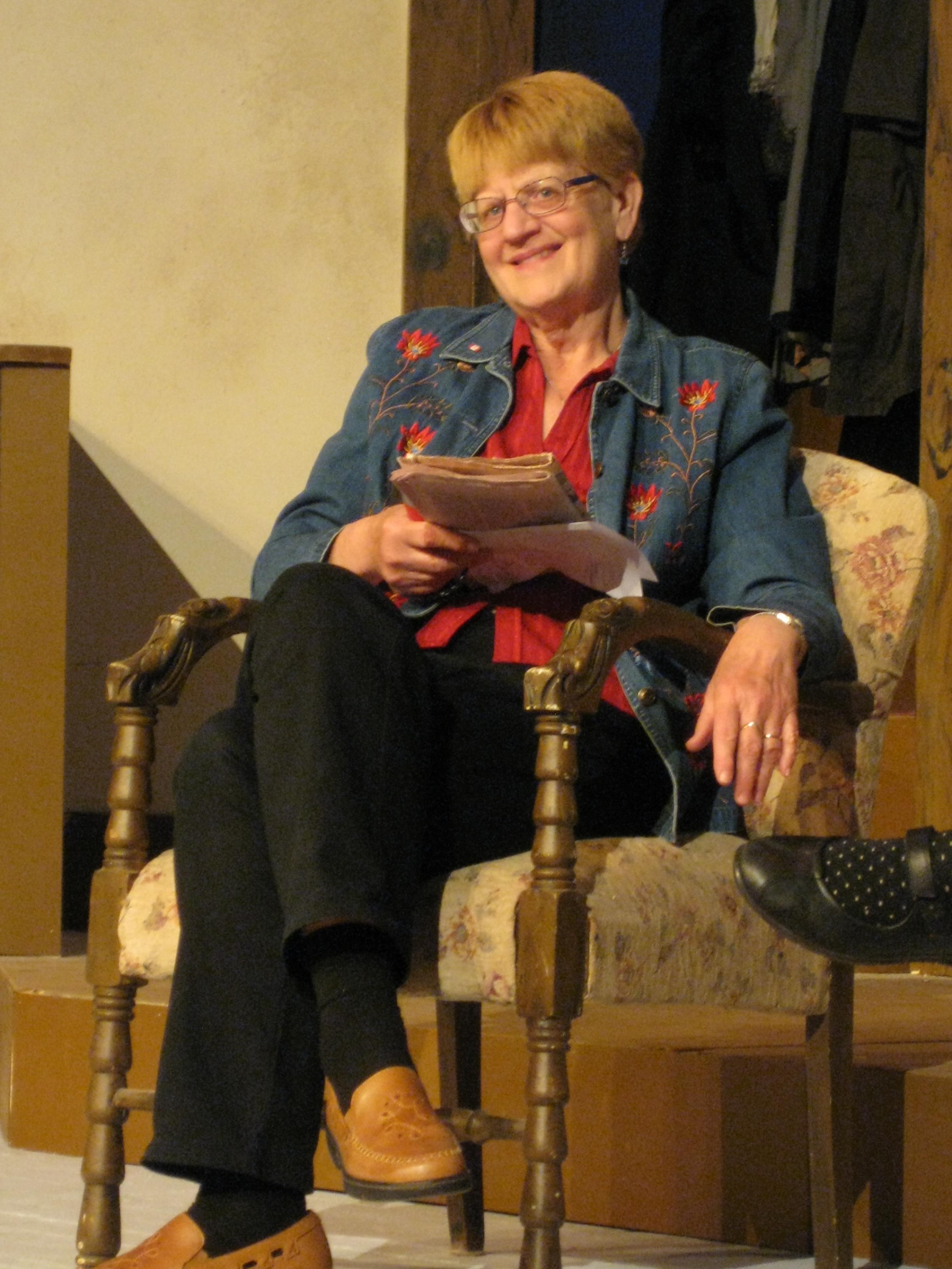 DARLENE REYNOLDS / Props Mistress & Co-Set Decorator (sitting on the job again).